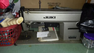 1 JUKI INDUSTRIAL SEWING MACHINE WITH METAL TABLE OBO