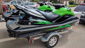 TWO 2009 KAWASAKI ULTRA 260X JET SKI'S AND TRITON TRAILER
