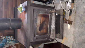 """16 """" Osburn fireplace. Including piping."""