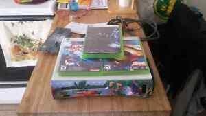 Xbox 360 défectueuse et jeux a vendre.
