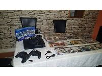 PS3 slim 320gb 4 controlers 1 microphone ps3 and 32 games