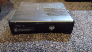 xbox 360 w/ 3 controllers, headset and game