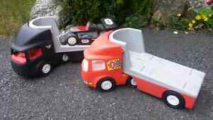 2 little tikes transport trucks with race car