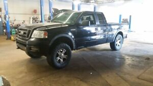 "2005 Ford f150 fx4 4x4 5.4 v8 ex cab lifted 4.5in with 35"" tires"