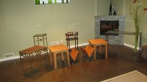 TWO TABLES AND NEWSPAPER HOLDERS FOR SALE.