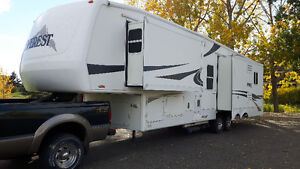 PRICE REDUCED!!!  Everest 5th wheel trailer and F350