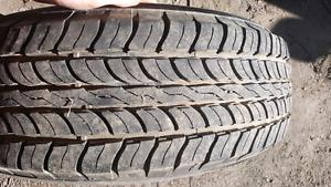 Four 245 75 R16 all season tires on rims for sale.