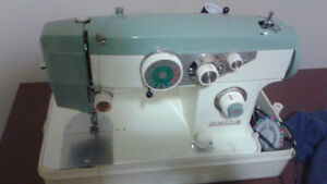 White sewing machine with extras!