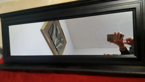 Wall mirror with attached shelf