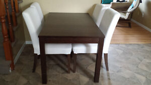 Ikea bjursta expandable table and 4 henriksdal chairs