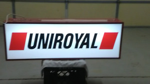 Double sided lighted Uniroyal sign