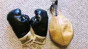 Vintage leather speed ball and boxing gloves
