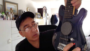 First Act Mini Guitar with built in speaker  black color
