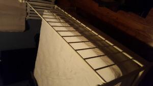 Queen Cast iron bed frame and mattress.