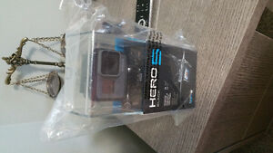 GoPro hero 5 black. New, box never been openew.  With 1 year war
