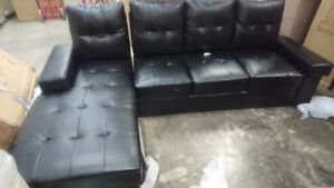 Black Leather Tuffed Sectional