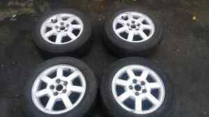 Cadillac rims with snow tires  London Ontario image 1
