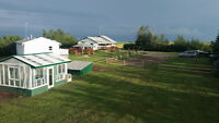 Two Residences! Setup 4 Horses! Stunning Barn with Man Cave!