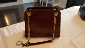 Guess shiny leather purse. Dark Rouge.