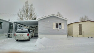 GREAT price on this mobile home in Watergrove in Calgary!