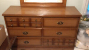 Two dressers and mirror.