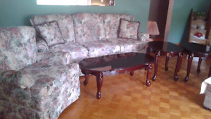 Floral couch and matching swivel rocker
