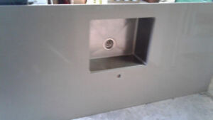 Counter top with undermount, single, stainless steel sink.
