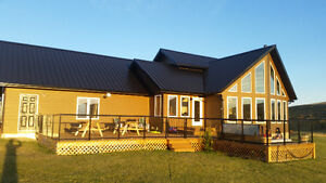 New Home for rent 20 minutes west of Claresholm on 48 acres.