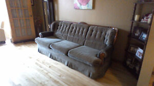Couch and chair with wood trim