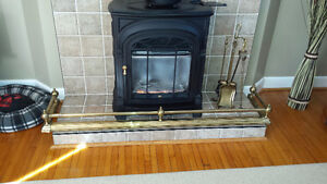 Brass fireplace fender and tools