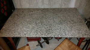 Nice solid granite table with 4 chairs