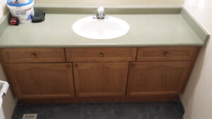 "63"" solid oak bathroom vanity plus countertop sink and faucet."