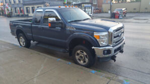 2013 Ford F250 FX4 truck with plow