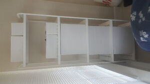 Ikea white metal shelving unit with storage boxes