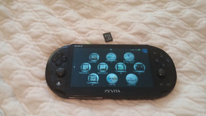 Ps vita, 32 gb card, 8gb card and case
