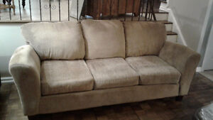 Beige sofa and love seat