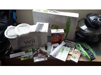 Wii console and Wii fit plus extras