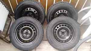 Barely used winter tires and rims for sale