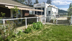 FOR SALE:  80 FEET OF GLASS RAILING WITH WHITE ALUMINUM TRIM.