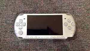 Sony PSP console with Charger + games