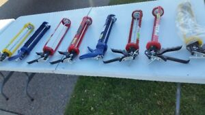 BRAND NEW LARGE CAULKING GUNS AND REGULAR SIZE CAULKING GUNS