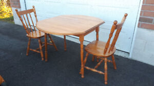 Small maple table with two chairs, folding sides