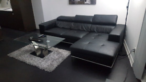 Modern black leather sectional couch