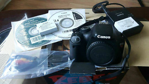 Canon t2i with accessories and 2 batteries