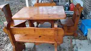 solid wood table  with two bench seats and two chairs
