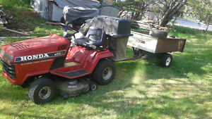 Honda ride mower with bagger and trailer, works like new. asking