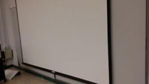 large,  roll-up wall screen 8ft x 8 ft