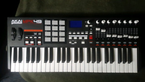 Akai Professional MPK 49 - $180 OBO. Stand and USB Cable incl'd