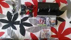 Ps3 avec 2 manettes, FIFA 16, Battlefield 4 et Monopoly streets