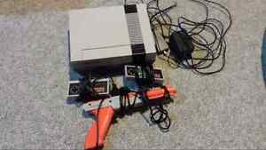 NES console with 2 controllers and a lightgun for sale